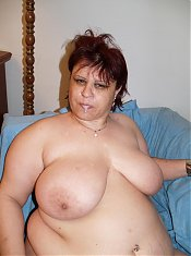 Experienced mature BBW Marta uses her pair of big tits to make a cock stiff and bones it live